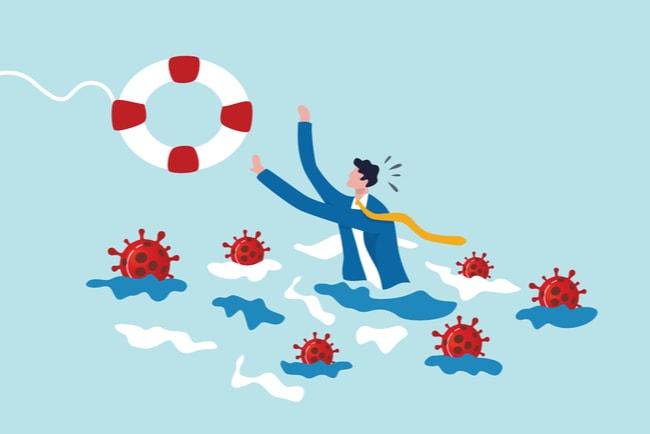 Illustration av en man i ett hav av coronavirus som får en livboj kastad till sig.